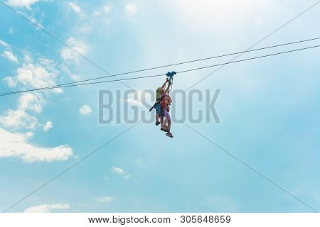 poster of Brother And Sister Go Down The Rope In An Extreme Park. People With The Block Hold On To The Rope An