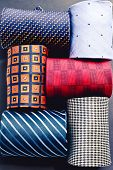Showcase With Multicolored Ties. View Of Different Colors Ties In Showcase. Showcase Of Rolled Neckt poster