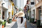 Young Woman Traveling With White Dress And Hat, Happy Asian Traveler Walking At Haji Lane And Arab S poster
