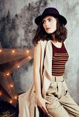 Young Pretty Woman Waiting Alone In Modern Loft Studio, Fashion Clothers Wearing Hat, Lifestyle And  poster