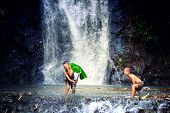Children Playing In Waterfall.the Refreshing Of The Israel Childrens Family When They Play The Wate poster