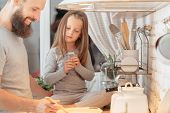 Happy Family. Curious Little Girl Watching Her Father Cooking Dinner In Kitchen. Bearded Man Enjoyin poster