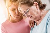 Young Adult Woman Consoles Sad Senior Adult Female. poster