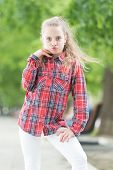 Fashion Generation. Adorable Girl Of Fashion Wearing Plaid Shirt On Summer Day. Fashionable Little C poster