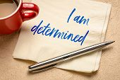 I am determined positive affirmation - handwriting on a napkin with a cup of coffe poster