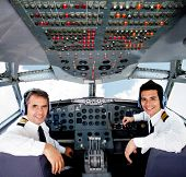 foto of cabin crew  - Pilots sitting in an airplane cabin flying on auto - JPG