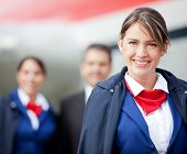 foto of cabin crew  - Beautiful flight attendant with the cabin crew at the background - JPG