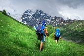 Hiking. Men On Hiking Trail. Trekking In Mountains. Tourists With Backpack Hike To Mountain Peak. Sp poster