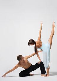 stock photo of ballet dancer  - two modern ballet dancers posing on white - JPG