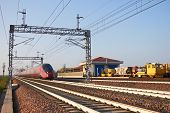 foto of railroad yard  - Speed train on Railroad track vanishing into the distance - JPG