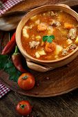 pic of stew pot  - Delicious veal stew soup with meat and vegetables on wood - JPG