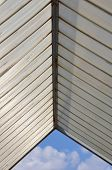 image of canopy roof  - Sunshade plastic roofing and blue sky abstract architecture background - JPG
