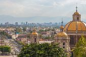 picture of guadalupe  - Old Basilica of Guadalupe with Mexico City skyline behind it - JPG