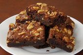 foto of brownie  - Close up of a plate of fudge nut brownies - JPG