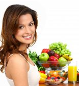 stock photo of pretty girl  - Young smiling woman with fruits and vegetables - JPG