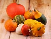 stock photo of marrow  - Heap of Various Marrow Squash and Pumpkins on Wooden background - JPG