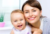 stock photo of hug  - Mother and Baby kissing and hugging at Home - JPG