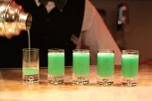 image of absinthe  - Closeup of five green absinthe alcohol shots - JPG