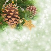 foto of merry chrismas  - chrismas tree and pine cones on background with sparkles - JPG