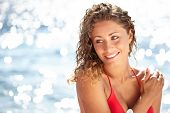 stock photo of sun-tanned  - Young beautiful happy smiling cheerful tanned woman with sun - JPG