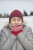 image of shivering  - Portrait of young man shivering in cold temperature - JPG