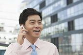 stock photo of button down shirt  - Young Businessman in pink button down shirt on the phone - JPG