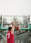 picture of slam  - Slam dunk by young man - JPG