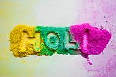 stock photo of holi  - holi written background created with dry holi powder colors - JPG