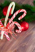 picture of candy cane border  - Christmas decoration with candy cane on wooden background
