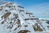 stock photo of avalanche  - Anti avalanche structures on the side of a mountain in Austria nearby Kaltenbach in Zillertal valley - JPG