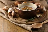 stock photo of sackcloth  - Composition with mushroom soup in pot - JPG