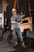 image of heavy equipment operator  - Young construction worker and forklift operator  on site - JPG