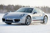 LEVI, FINLAND - FEB 20: Unknown driver powerslides a PORSCHE 911 CARRERA 4S car during Porsche Drivi