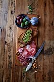 stock photo of kalamata olives  - Mediterranean Antipasti on Wooden Board - JPG