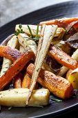 image of parsnips  - Roasted root vegetables on a black serving platter - JPG