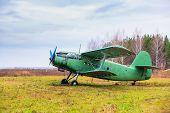 stock photo of time flies  - Old airplane on field in autumn time - JPG