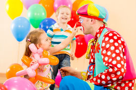 pic of clowns  - happy children and clown on birthday party - JPG