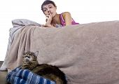 image of shhh  - girl unable to sleep because of noisy pet house cat - JPG