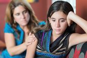 image of depressed teen  - Sad teenage girl being comforted by her mother - JPG
