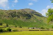 stock photo of dungeon  - Langdale Valley Lake District Cumbria near Old Dungeon Ghyll England UK in summer blue sky and clouds scenic - JPG
