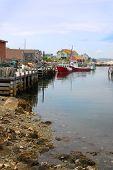 stock photo of shacks  - Coastal village of Peggys Cove Nova Scotia Canada showing seaside shacks fishing boats and houses along the coast - JPG