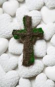 foto of condolence  - Mourning or condolence white background with a green handmade cross of wood.