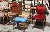 picture of chassis  - Collection of old antique and broken chairs on the flea market.