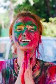 image of holi  - European girl celebrate festival Holi in Delhi - JPG