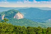 stock photo of asheville  - Majestic Looking Glass Rock mountain along the Blue Ridge Parkway in North Carolina - JPG