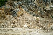 foto of landslide  - road is blocked by a land slide of rock and debris to where it is a hazard for drivers in cars - JPG