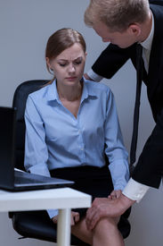 picture of inappropriate  - Problem of sexual harassment at work vertical - JPG