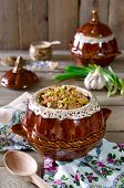 picture of pot roast  - Buckwheat with meat in a pot on the wooden table - JPG