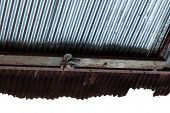 picture of shacks  - a shack ceiling made of rusty and corroded metal sheet - JPG