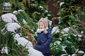 image of snowy owl  - adorable happy child girl in owl knitted hat on the walk in winter snowy garden - JPG